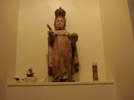 This is a plaster reproduction of the Infant of Prague. My mother in law found it in a junk shop in Mexico.