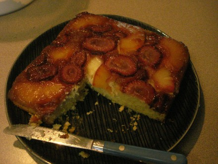 Strawberries have been cheap and plentiful lately, so I used some to garnish this pineapple upside-down cake.