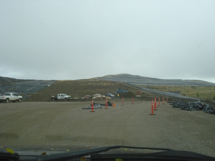 Here's the dump site - a great improvement over the old days, where you just drove your vehicle right onto the shifting trash mountain and emptied it as fast as you could. They now have a couple of guys watching, so you can't get away with dumping just anything - it's all much more controlled.