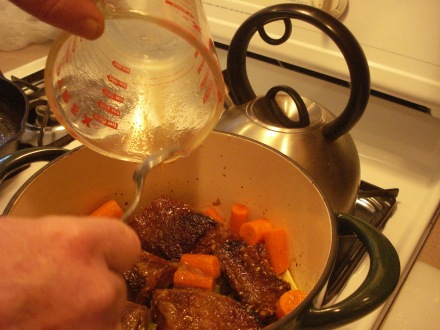 """Here's where the """"slow cooking"""" begins - everything goes in the pot, topped with that crazy sauce, and sits on the stove for the rest of the day, driving everybody including the dogs completely insane with hunger."""