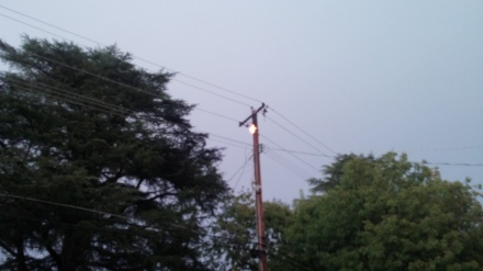 My husband got out in time to see the pole still burning. The transformer was laying in parts on the ground, hanging from loose wires.