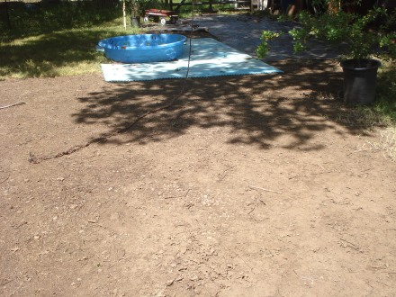 "For now, I will use the black plastic and some old ""sport court"" some friends gave us to keep the mud out of the pool."