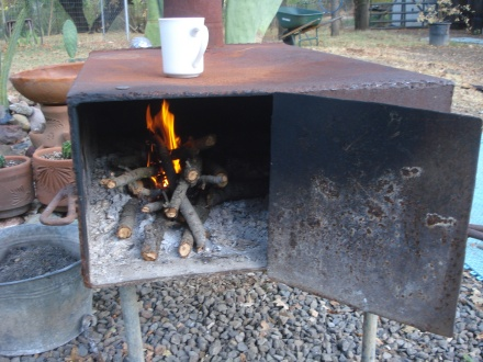 I don't know where my grandpa got this campstove, but it was obviously homemade with portability in mind.